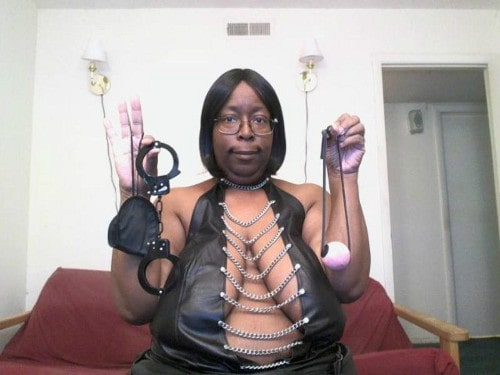 fat black woman holding up handcuffs