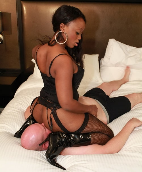 ebony mistress sits on sub face